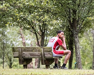 DIANNA OATRIDGE | THE VINDICATOR Chaney's William Ford rests after running the course at the Suburban Cross Country meet at Austintown Park on Tuesday.