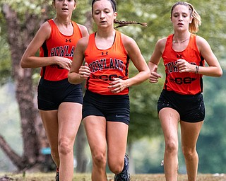 DIANNA OATRIDGE | THE VINDICATOR Howland's Gabby Reuschling (left), Maria Dellimuti (center), and Elenie McNally (right) compete at the Suburban Cross Country meet at Austintown Park on Tuesday.
