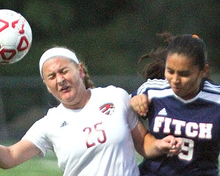 Canfield's Hannah Stein (25) and Austintown Fitch's Jackie Arroyo (19) battle for control of the ball during a game Wednesday night, Canfield won, 7-0.