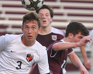 William D. Lewis The Vindicator Howland's Francis Cesta(3) heads the ball as Boardman's Brian Yauger and Trevor Boggess defend during 9-13-18 action at Boardman.