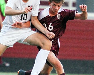 William D. Lewis The Vindicator Howland's Pano Gentis(10) and Boardman's Jake Hughes(36) during 9-13-18 action at Boardman.
