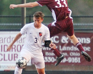 William D. Lewis The Vindicator  Boardman's Chris Barber(33) and Howland's Francis Cesta(3) during 9-13-18 action at Boardman.