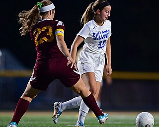 NORTH LIMA, OHIO - OCTOBER 1, 2018: Poland's Molly Malmer moves the ball ahead of South Range's Natalie Plunkett during the first half of their game, Monday night at South Range High School. DAVID DERMER   THE VINDICATOR