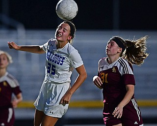 NORTH LIMA, OHIO - OCTOBER 1, 2018: Poland's Molly Malmer heads the ball away from South Range's Hannah Ritchie during the first half of their game, Monday night at South Range High School. DAVID DERMER   THE VINDICATOR