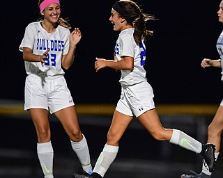 NORTH LIMA, OHIO - OCTOBER 1, 2018: Poland's Mia Marantis, right, is congratulated by Bella Milano after scoring a goal during the second half of their game, Monday night at South Range High School. DAVID DERMER   THE VINDICATOR