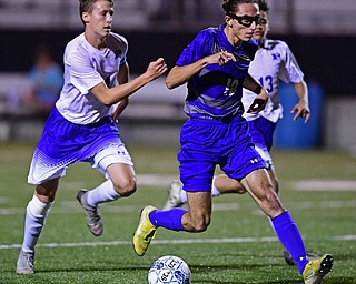 HUBBARD, OHIO - OCTOBER 9, 2018: Hubbard's AJ Trobek dribbles the ball ahead of Poland's Sam Scotford and Justice Gonzalez during the second half of their game, Tuesday night at Hubbard Eagles Stadium. DAVID DERMER | THE VINDICATOR
