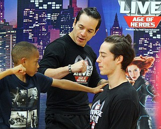 William D. Lewis The vindicator Brendon Ballard, 9, of Hermitage whose mother is master sgt Lacey Harris at YARS, gets training from Marvel Universe Live characters Nick Nieves, left, and Connor Vansandt during an event 10-10-18 at YARS.