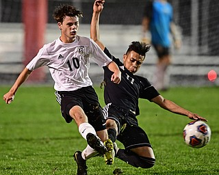 CAMPBELL, OHIO - OCTOBER 9, 2018: Crestview's Daven Manley kicks the ball away from Campbell's Henry Perdomo Mejia during the first half of their game, Wednesday night at Campbell High School. DAVID DERMER | THE VINDICATOR