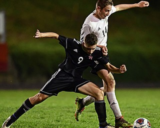 CAMPBELL, OHIO - OCTOBER 9, 2018: Campbell's Petros Atsas and Crestview's Colt Crane battle for the ball during the first half of their game, Wednesday night at Campbell High School. DAVID DERMER | THE VINDICATOR