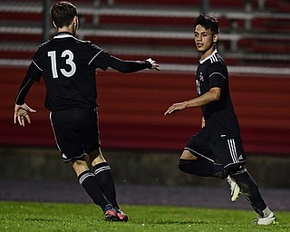 CAMPBELL, OHIO - OCTOBER 9, 2018: Campbell's Henry Perdomo Mejia, right, is congratulated by Gabe Lisi after scoring a goal during the first half of their game, Wednesday night at Campbell High School. DAVID DERMER | THE VINDICATOR