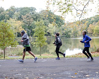 Race participants run past Lake Glacier during the Youngstown Peace Race 10K on Sunday morning. EMILY MATTHEWS | THE VINDICATOR