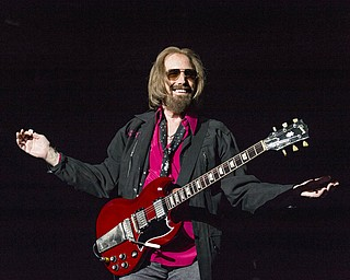 In a Sept. 17, 2017 file photo, Tom Petty and the Heartbreakers perform at KAABOO 2017 at the Del Mar Racetrack and Fairgrounds, in San Diego, Calif. Hundreds of members of the Tom Petty Nation! fan club visited Gainesville  on Saturday to celebrate the star's birthday with his music and the dedication of the former Northeast Park as Tom Petty Park.