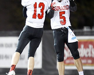 Girard's Michael Johnson, left, and Nick Malito celebrates after Malito scores a touchdown against East during the first half of their game at Stambaugh Stadium on Saturday.  EMILY MATTHEWS | THE VINDICATOR