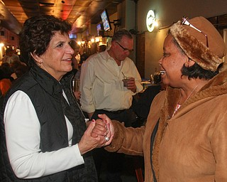 William D. Lewis The Vindicator   Carol Rimedio-Righetti. Mahoning commissioner gets congrats from Audrey Tillis of Austintown during an election night watch party at Avalon in Youngstown.