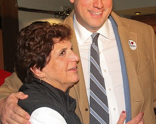 William D. Lewis The Vindicator  Tim Ryan gets a hug from Carol Rimedio Righetti during election night watch party at Avalon in Youngstown.