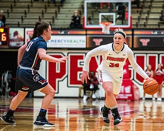 DIANNA OATRIDGE | THE VINDICATOR  Youngstown State's McKenah Peters (34) dribbles the ball upcourt against Robert Morris's Megan Callahan (13) during their game at Beeghly Center in Youngstown on Tuesday.