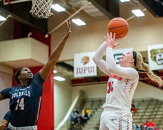 DIANNA OATRIDGE | THE VINDICATOR  Youngstown State's McKenah Peters puts up a shot over Robert Morris's Irekpitan Ozzy-Momodu during their game at Beeghly Center in Youngstown on Tuesday.