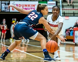 DIANNA OATRIDGE | THE VINDICATOR  Youngstown State's Deleah Gibson (4) passes the ball around Robert Morris's Esther Castedo (22) during their game at Beeghly Center in Youngstown on Tuesday.