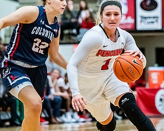 DIANNA OATRIDGE | THE VINDICATOR  Youngstown State's Alison Smolinski (2) drives to the hoop against Robert Morris's Esther Castedo (22) during their game at Beeghly Center in Youngstown on Tuesday.