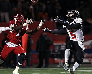 NILES, OHIO - November 10, 2018: GIRARD INDIANS vs PERRY PIRATES at Bo Rein Stadium-  1st qtr., Girard Indians' Nick Malito (5) catches a 44 yards td as Perry Pirates' Jaylen Anderson (1) defends.  MICHAEL G. TAYLOR | THE VINDICATOR