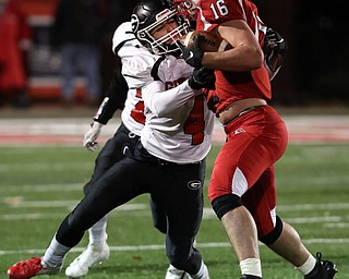 NILES, OHIO - November 10, 2018: GIRARD INDIANS vs PERRY PIRATES at Bo Rein Stadium-  2nd qtr., Girard Indians' Aiden Warga (4) tackles Perry Pirates' Jacob Allen (16) for short gain.  MICHAEL G. TAYLOR | THE VINDICATOR