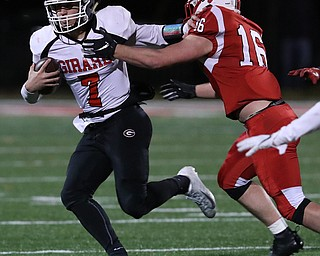 NILES, OHIO - November 10, 2018: GIRARD INDIANS vs PERRY PIRATES at Bo Rein Stadium-  2nd qtr., Girard Indians' Mark Waid (7) stiff arms Perry Pirates' Jacob Allen (16) to pickup the 1st down.  MICHAEL G. TAYLOR | THE VINDICATOR