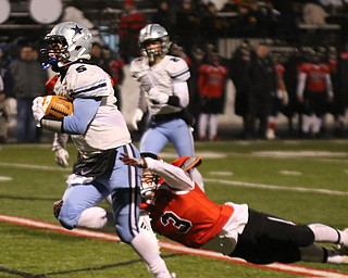 ROBERT  K. YOSAY | THE VINDICATOR..Canfield Cardinals lose in a Division III Region 9  final at Warren's Mollenkopf stadium ...#5 Kenston's Jack Porter breaks loose from Canfield 33 McCoy Watkins during first half action