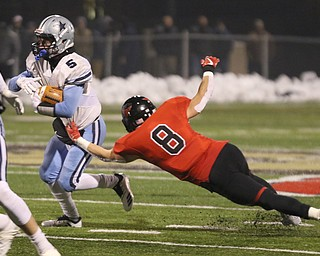ROBERT  K. YOSAY | THE VINDICATOR..Canfield Cardinals lose in a Division III Region 9  final at Warren's Mollenkopf stadium ...Kenston's Jack Porter #5.. gets stopped behind the line by Canfields #8 Colin Hritz  during first half action
