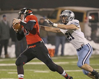 ROBERT  K. YOSAY | THE VINDICATOR..Canfield Cardinals lose in a Division III Region 9  final at Warren's Mollenkopf stadium ...Canfields Nick Crawford tries to elude #21 Kenston's Jake Englehart  as he goes for a first down during first half action
