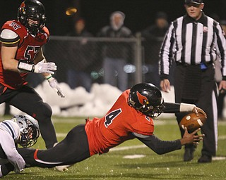 ROBERT  K. YOSAY | THE VINDICATOR..Canfield Cardinals lose in a Division III Region 9  final at Warren's Mollenkopf stadium ...Canfields #4 Mehlyn Clinkscale as Kenston #2  Tyler Mintz as Mehlyn reached for a first down that set up the Cardinals Touchdown during third quarter action