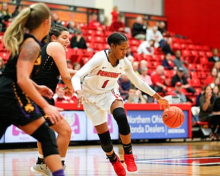 YSU's Amara Chikwe dribbles the ball to try to keep it away from Carlow's Bria Rathway, center, and Delaney Daly, left, during their game Friday night at YSU. EMILY MATTHEWS | THE VINDICATOR