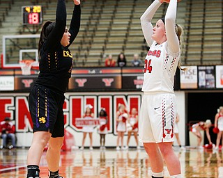YSU's McKenah Peters looks to pass the ball as Carlow's Emily Grandy tries to block her during their game Friday night at YSU. EMILY MATTHEWS | THE VINDICATOR