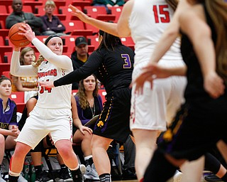 YSU's McKenah Peters looks to pass the ball  during their game against Carlow Friday night at YSU. EMILY MATTHEWS | THE VINDICATOR