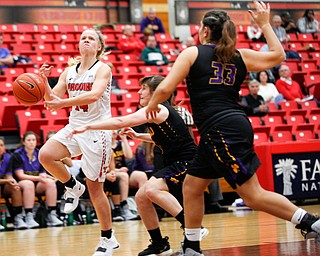 YSU's Melinda Trimmer loses control of the ball during their game against Carlow on Friday night at YSU. EMILY MATTHEWS | THE VINDICATOR