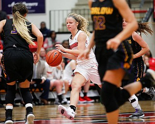 YSU's Melinda Trimmer dribbles the ball down the court during their game against Carlow on Friday night at YSU. EMILY MATTHEWS | THE VINDICATOR