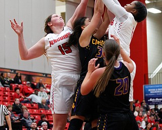 YSU's Mary Dunn, left, and Amara Chikwe work to get the ball into the basket as Carlow tries to block and get to the ball during their game Friday night at YSU. EMILY MATTHEWS | THE VINDICATOR