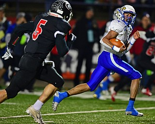 NILEs, OHIO - NOVEMBER 17, 2018: Hubbard's Davion Daniels runs away from Girard's Nick Malito and into the end zone to score a touchdown during the first half of the OHSAA Division 4 Region 13 Regional Final game, Saturday night at Niles McKinley High School. DAVID DERMER | THE VINDICATOR