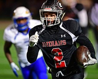 NILEs, OHIO - NOVEMBER 17, 2018: Girard's Morgan Clardy runs down the sideline during the first half of the OHSAA Division 4 Region 13 Regional Final game, Saturday night at Niles McKinley High School. DAVID DERMER | THE VINDICATOR