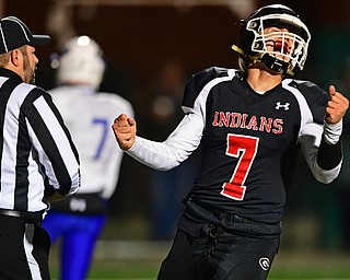 NILEs, OHIO - NOVEMBER 17, 2018: Girard's Mark Waid celebrates after throwing a touchdown pass during the first half of the OHSAA Division 4 Region 13 Regional Final game, Saturday night at Niles McKinley High School. DAVID DERMER | THE VINDICATOR