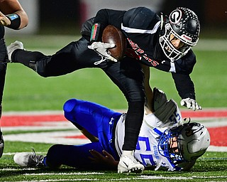 NILEs, OHIO - NOVEMBER 17, 2018: Girard's Morgan Clardy fights off a tackle from Hubbard's Mark Jones during the first half of the OHSAA Division 4 Region 13 Regional Final game, Saturday night at Niles McKinley High School. DAVID DERMER | THE VINDICATOR
