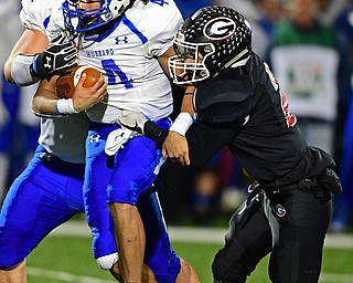NILEs, OHIO - NOVEMBER 17, 2018: Hubbard's Davion Daniels is tackled by Girard's Morgan Clardy during the first half of the OHSAA Division 4 Region 13 Regional Final game, Saturday night at Niles McKinley High School. DAVID DERMER | THE VINDICATOR