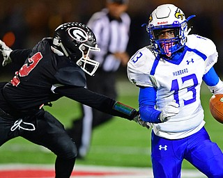 NILEs, OHIO - NOVEMBER 17, 2018: Hubbard's XXX runs away from Girard's XXX during the second half of the OHSAA Division 4 Region 13 Regional Final game, Saturday night at Niles McKinley High School. DAVID DERMER | THE VINDICATOR