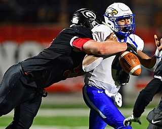 NILEs, OHIO - NOVEMBER 17, 2018: Girard's XXX hits Hubbard's XXX ,forcing a fumble that would be recovered by Girard, during the second half of the OHSAA Division 4 Region 13 Regional Final game, Saturday night at Niles McKinley High School. DAVID DERMER   THE VINDICATOR