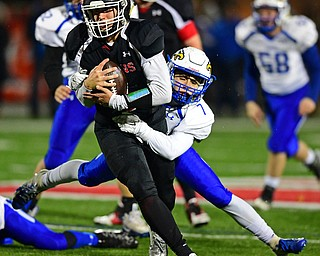 NILEs, OHIO - NOVEMBER 17, 2018: Girard's Mark Waid is tackled by Hubbard's Cam Resatar  during the second half of the OHSAA Division 4 Region 13 Regional Final game, Saturday night at Niles McKinley High School. DAVID DERMER | THE VINDICATOR
