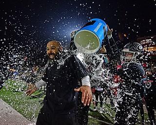 NILEs, OHIO - NOVEMBER 17, 2018: Girard head coach Pat Pearson gets a bath after Girard defeated Hubbard to win the Division 4 Region 13 championship, Saturday night at Niles McKinley High School. DAVID DERMER | THE VINDICATOR