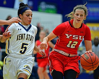 KENT, OHIO - NOVEMBER 20, 2018: Youngstown State's Chelsea Olson dribbles away from Kent State's Mariah Modlkins during the first half of their game, Tuesday night at the Memorial Athletic and Convocation Center. Kent State won 62-34. (David Dermer/Special to the Record Courier)