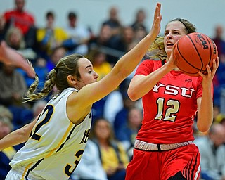 KENT, OHIO - NOVEMBER 20, 2018: Youngstown State's Chelsea Olson puts up a shot while being pressured by Kent State's Hannah Young during the first half of their game, Tuesday night at the Memorial Athletic and Convocation Center. Kent State won 62-34. (David Dermer/Special to the Record Courier)