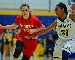 KENT, OHIO - NOVEMBER 20, 2018: Youngstown State's Chelsea Olson drives on Kent State's Megan Carter during the second half of their game, Tuesday night at the Memorial Athletic and Convocation Center. Kent State won 62-34. (David Dermer/Special to the Record Courier)
