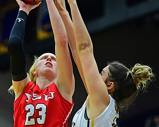 KENT, OHIO - NOVEMBER 20, 2018: Youngstown State's Sarah Cash goes to the basket against Kent State's Lindsey Thall during the second half of their game, Tuesday night at the Memorial Athletic and Convocation Center. Kent State won 62-34. (David Dermer/Special to the Record Courier)