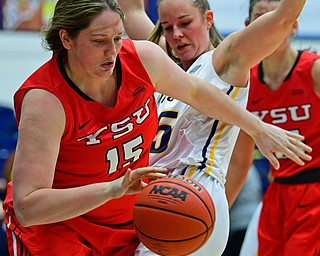 KENT, OHIO - NOVEMBER 20, 2018: Youngstown State's Mary Dunn dribbles the ball away from Kent State's Sydney Brinlee during the second half of their game, Tuesday night at the Memorial Athletic and Convocation Center. Kent State won 62-34. (David Dermer/Special to the Record Courier)